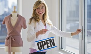 female clothing store worker opening up shop